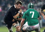All Blacks captain Richie McCaw runs at Sean O'Brian of Ireland during their rugby union international at AMI Stadium in Christchurch on June 16. The All Blacks beat Ireland 22-19