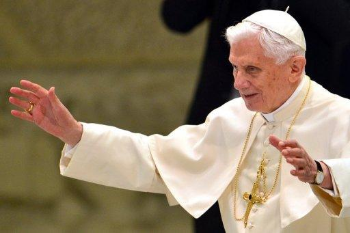 Pope Benedict XVI waves as he arrives on September 19, 2012 for his weekly general audience in the Paul VI hall at the Vatican. The pope on Wednesday called for Christians and Muslims to unite against violence, following a trip to Lebanon last week in which he condemned fundamentalism in any religion.
