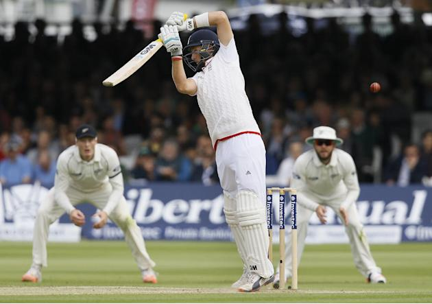 England's Joe Root plays a shot off the bowling of New Zealand's Tim Southee during the fourth day of the first Test match between England and New Zealand at Lord's cricket ground in Londo