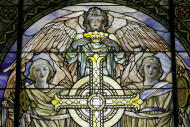 "In this Thursday, Oct. 25 2012 photo, a detail of ""The Righteous Shall Receive a Crown of Glory,"" Brainard Memorial Window for Methodist Church, Waterville, New York, ca. 1901 is photographed while on display at the ""Louis C. Tiffany and the Art of Devotion"" exhibit at the Museum of Biblical Art in New York. (AP Photo/Mary Altaffer)"