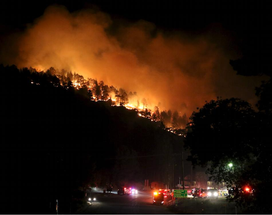 Los Angeles county firefighters battle wild land fire call the Pine Fire in Wrightwood, California