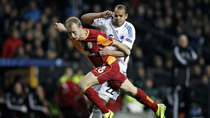 Galatasaray's Semih Kaya and FC Copenhagen's Daniel Braaten of Norway compete for the ball during their Champions League Group B soccer match at Parken Stadium, Copenhagen, Denmark, Tuesday Nov. 5, 2013