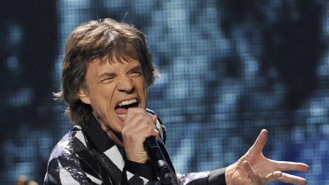 """Mick Jagger of the Rolling Stones performs on the kick-off of the band's """"50 and Counting"""" tour at the Staples Center on Friday, May 3, 2013 in Los Angeles. (Photo by Chris Pizzello/Invision/AP)"""