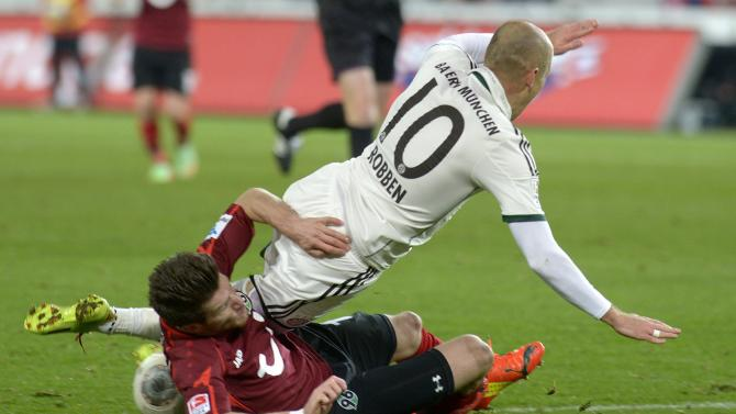 Hanover's Pocognoli and Bayern Munich's Robben fight for the ball during their German Bundesliga first division soccer match in Hanover