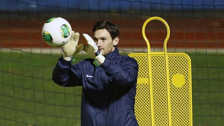 France's soccer goal keeper and captain Hugo Lloris catches the ball during a training session at Clairefontaine training center, south of Paris, Monday, Nov. 11, 2013, ahead of their 2014 World Cup qualifying soccer match against Ukraine