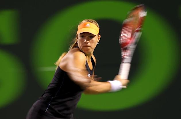 Angelique Kerber of Germany returns a shot to Serena Willaims during the Sony Open at Carndon Park Tennis Center on March 25, 2014 in Key Biscayne, Florida