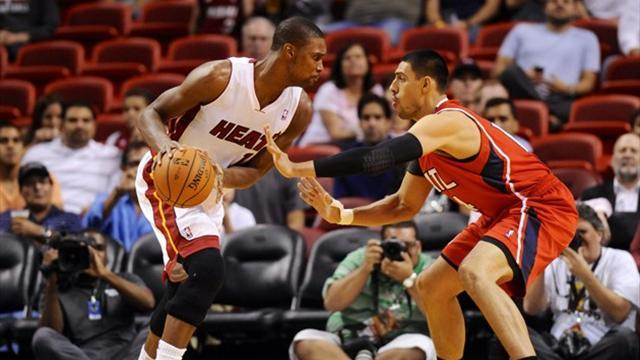 Basketball - Bosh on form as Heat suffocate Hawks
