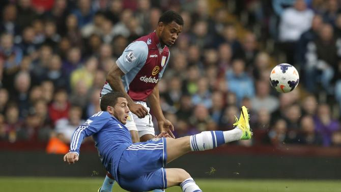 Chelsea's Hazard challenges Aston Villa's Bacuna during their English Premier League soccer match at Villa Park in Birmingham