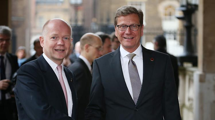 British foreign Secretary William Hague, right, greets German Foreign Minister Guido Westerwelle at the G8 Foreign Ministers meeting at Lancaster House Thursday April 11, 2013 in London, England. G8 Foreign Ministers are holding a two day meeting where they will discuss the situation in the Middle East, including Syria and Iran, security and stability across North and West Africa, Democratic People's Republic of Korea and climate change. British Foreign Secretary William Hague will also highlight five key policy priorities.  (AP Photo / Peter Macdiarmid , pool