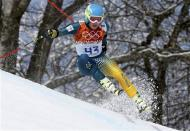 Australia's Dominic Demschar skis during the first run of the men's alpine skiing giant slalom event at the 2014 Sochi Winter Olympics at the Rosa Khutor Alpine Center February 19, 2014. REUTERS/Stefano Rellandini