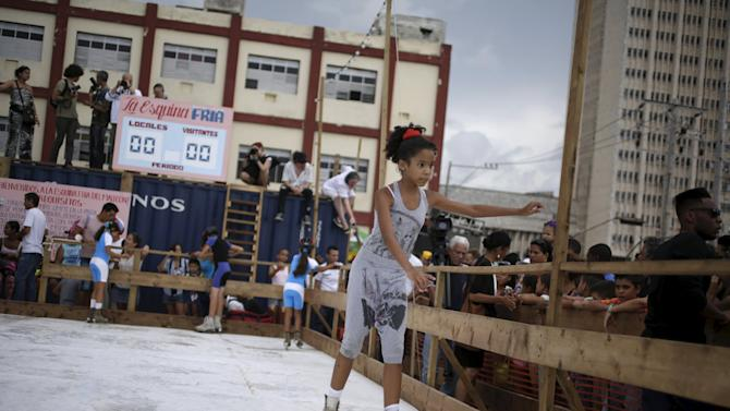 """A girl skates in an artificial ice rink, a creation of U.S. artist Duke Riley called """"La esquina fria"""" for the 12th Havana Biennial, at Havana's seafront boulevard """"El Malecon"""""""