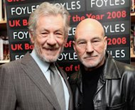 Ian McKellen and Patrick Stewart pose for photos before reading from 'The Letters of Samuel Beckett', and discussing their roles in a production of Waiting for Godot opening in London on 26 February, 2009 -- Getty Images