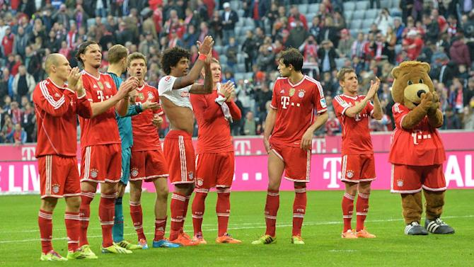 Bayern's players celebrates to supporters after the German first division Bundesliga soccer match between FC Bayern Munich and SC Freiburg in Munich, Germany, on Saturday, Feb. 15, 2014. Bayern won 4-0