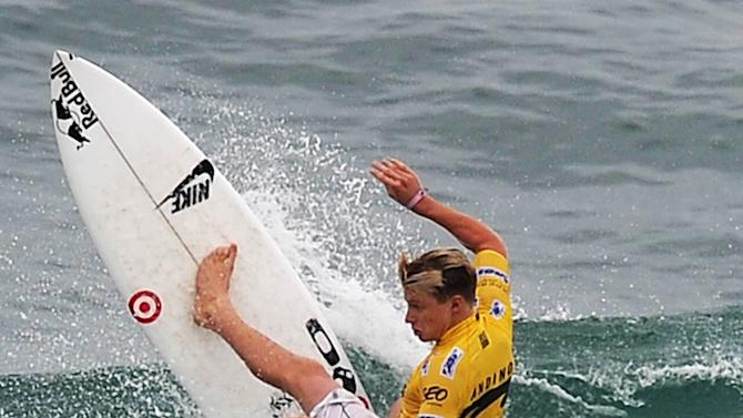 US surfer Koloche Andino competes in the Association of Surfing Professionals' men's 2012 ASP World Championship Tour at Barra da Tijuca beach in Rio de Janeiro, Brazil, on May 14, 2012.  AFP PHOTO/VANDERLEI ALMEIDAVANDERLEI ALMEIDA/AFP/GettyImages