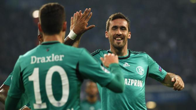 Schalke 04's Fuchs and Draxler celebrate goal against Steaua Bucharest during their Champions League group E soccer match in Gelsenkirchen