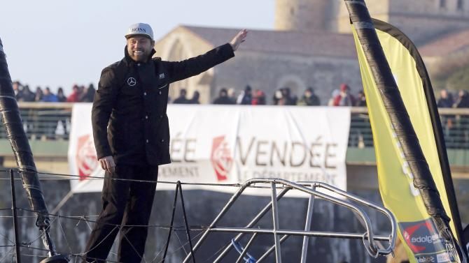 British sailor Alex Thomson waves as he completes the solo round-the-world Vendee Globe sailing race in Les Sables d'Olonne