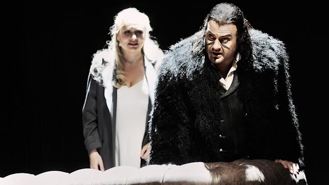 "In this undated photo provided by the Opernhaus Zurich Bryn Terfel in the role of the Hollaender (Dutchman), right, and Anja Kampe as Senta, left, perform on stage during a dress rehearsal for Richard Wagner's opera ""Der fliegende Hollaender"" (The Flying Dutchman) at the opera in Zurich, Switzerland. (AP Photo/Opernhaus Zurich/T+T Fotografie/Toni Suter + Tanja Dorendorf)"