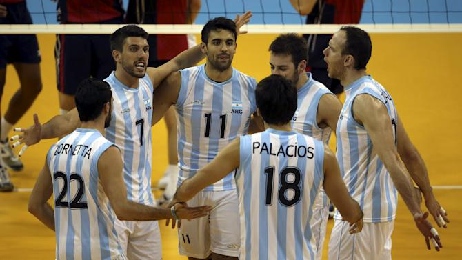 Argentina's players celebrate after winning their men's volleyball quarterfinals match against the United States at the 2015 Pan Am Games in Toronto