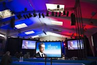 A hall with video screens representing campaign posters of France's incumbent president Nicolas Sarkozy is seen ahead of a rally in Avignon. He sued a website that claimed Moamer Kadhafi financed his 2007 presidential election, seeking to spin the charge in the crucial final week before France goes to the polls