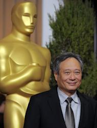 "FILE - In this Monday, Feb. 4, 2013 file photo, Ang Lee, nominated for best picture and directing for ""Life of Pi,"" arrives at the 85th Academy Awards Nominees Luncheon at the Beverly Hilton Hotel, in Beverly Hills, Calif. With 11 Academy Awards nominations, second only to ""Lincoln"" with 12, and the sort of global box-office receipts normally reserved for superheroes, ""Life of Pi"" is one of the most unusual megahits ever to hit the big-screen. (Photo by Chris Pizzello/Invision/AP, File)"