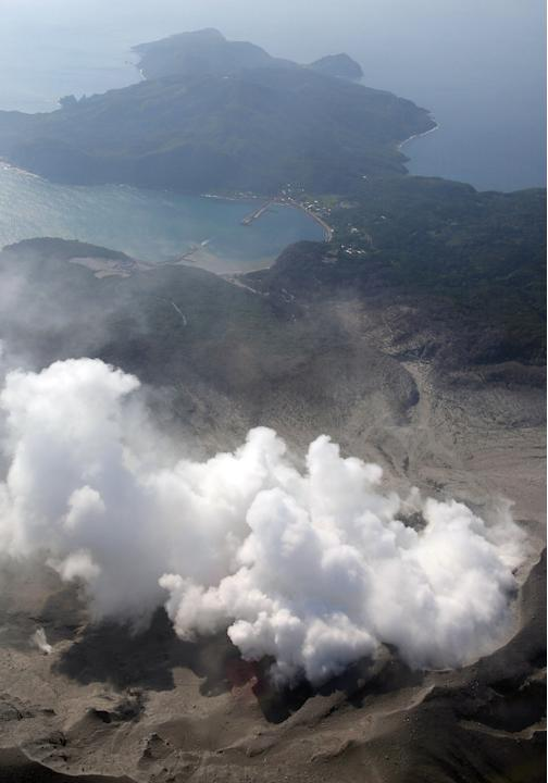 A column of smoke raises from Mount Shindake on Kuchinoerabu island, southern Japan, Friday, May 29, 2015. The volcano erupted in spectacular fashion on the small island on Friday, spewing out rocks a