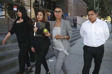 Companion of ex-NBA Clippers owner Donald Sterling, V. Stiviano, walks out of the courthouse in Los Angeles