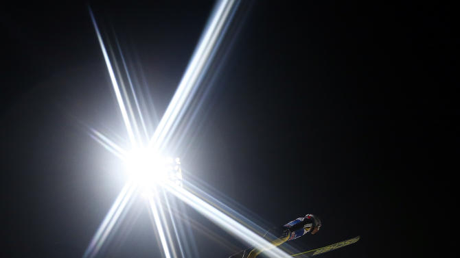 Ammann of Switzerland soars through the air during his qualification jump for the fourth event of the 61st four-hills ski jumping tournament in Bischofshofen