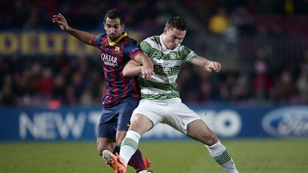 FC Barcelona's Martin Montoya, right, duels for the ball against Celtic's Derk Boerrigter during a Champions League soccer match group H at the Camp Nou in Barcelona, Spain, Wednesday, Dec. 11, 2013