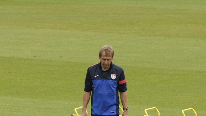 U.S. soccer head coach Jurgen Klinsmann, from Germany, walks on the pitch during a training session in Panama City, Monday, Oct.  14, 2013. The U.S. will face Panama in a 2014 World Cup qualifying soccer match, Tuesday