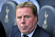 "Tottenham manager Harry Redknapp, pictured in May 2012, on Tuesday dismissed speculation that he has resigned from the Premier League side with a year left on his contract as ""scandalous"""