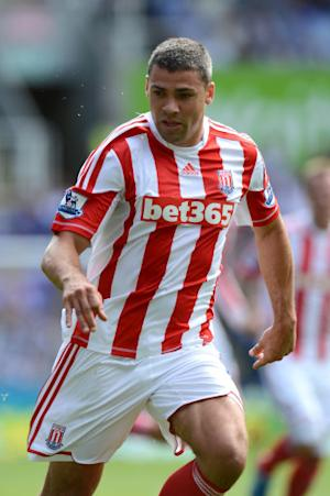 Jon Walters is happy to play out wide for his country