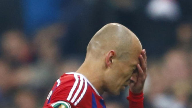 Bayern Munich's Robben reacts as he is substituted during German Cup semi-final soccer match against Borussia Dortmund in Munich