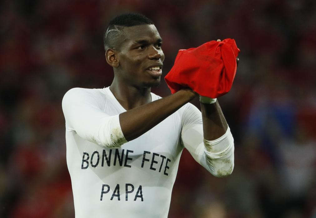 France's Paul Pogba applauds fans after the game