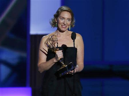 """Sarah Bromell accepts the award for Outstanding Writing for a Drama Series for """"Homeland"""" for her husband Henry Bromell, who died in March of this year, at the 65th Primetime Emmy Awards in Los Angeles"""