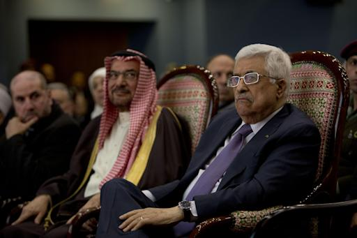 Palestinian President Mahmoud Abbas, right, with Secretary General of The Organization of The Islamic Conference Iyad Amin Madani during a ceremony of the