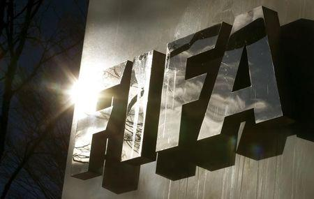 The sun is reflected in FIFA's logo in front of FIFA's headquarters in Zurich