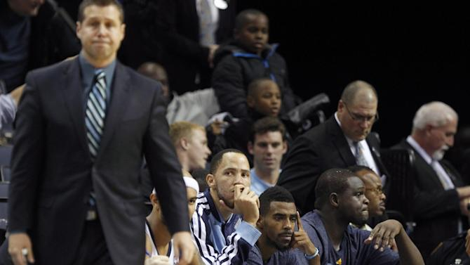 Memphis Grizzlies players Tayshaun Prince, Mike Conley and Zach Randolph, right, look on with head coach Dave Joerger as they drop more than 20 points behind Golden State in the second half of an NBA basketball game Saturday, Dec. 7, 2013, in Memphis, Tenn. Golden State won 108-82