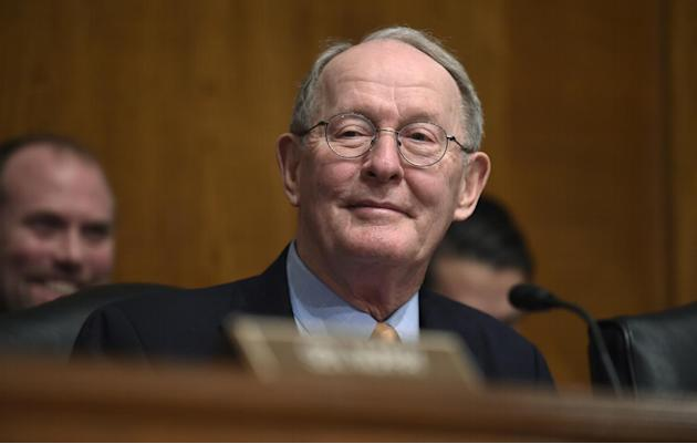 FILE - In this Jan. 21, 2015 file photo, Senate Health, Education, Labor and Pensions Committee Chairman Sen. Lamar Alexander, R-Tenn. listens to testimony on Capitol Hill in Washington. The Tennessee