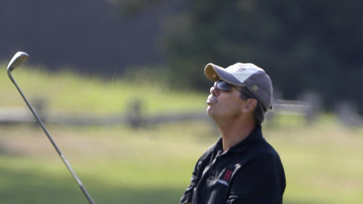 CORRECTS FIRST NAME TO GLENN-Businessman Glenn Hutchins reacts while playing golf with President Barack Obama, not shown, at Farm Neck Golf Club in Oak Bluffs, Mass., on the island of Martha's Vineyard, Saturday, Aug. 17, 2013. (AP Photo/Steven Senne)
