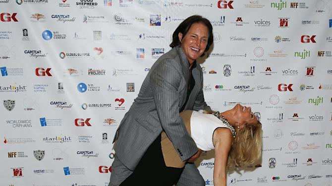 Bruce Jenner and Kathie Lee Gifford arrive at the Annual Charity Day hosted by Cantor Fitzgerald and BGC Partners, on Wednesday, Sept. 11, 2013, in New York. (Photo by Mark Von Holden/Invision/AP)