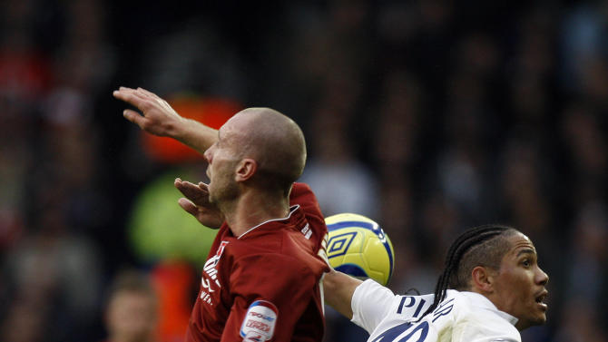 Tottenham's Steven Pienaar, right, vies for the ball with Cheltenham's Russell Penn during the FA Cup third round soccer match between Tottenham Hotspur and Cheltenham Town at White Hart Lane Stadium in London, Saturday, Jan. 7, 2012. (AP Photo/Kirsty Wigglesworth)