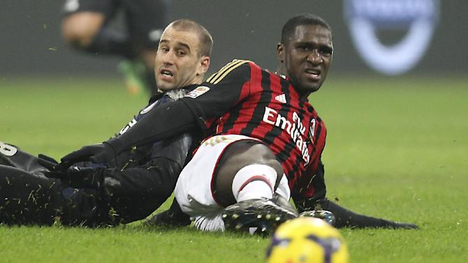 AC Milan defender Cristian Zapata, right, of Colombia, and Inter Milan forward Rodrigo Palacio, of Argentina, watch the ball, during a Serie A soccer match at the San Siro stadium in Milan, Italy, Sunday, Dec. 22, 2013