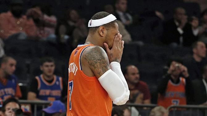 New York Knicks' Carmelo Anthony (7) walks off the court at the end of regulation during an NBA basketball game against the Atlanta Hawks Saturday, Nov. 16, 2013, in New York.  Atlanta defeated New York 110-90
