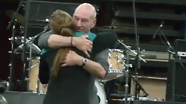 Patrick Stewart hugs a fan at Comicpalooza 2013.