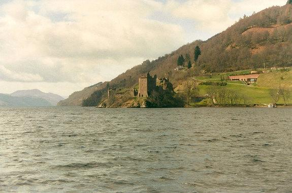 "The photo of the ""monster"" was taken from the woody shoreline of Loch Ness lake in the Highlands of Scotland, shown here with Urquhart Castle in the background."