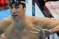 "US swimmer Michael Phelps gestures ""three"" with his fingers after winning gold in the men's 200m individual medley final at the London 2012 Olympic Games on August 2 -- a historic third consecutive win"