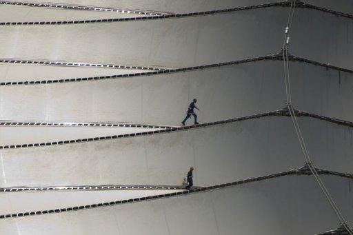 Aerial view of workers walking on the roof of the Maracana stadium, in Rio de Janeiro, Brazil on April 11, 2013