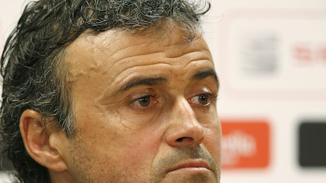 Barcelona's coach Luis Enrique listens to a question during a news conference after a training session at the Barcelona training grounds Ciutat Esportiva Joan Gamper in Sant Joan Despi near Barcelona