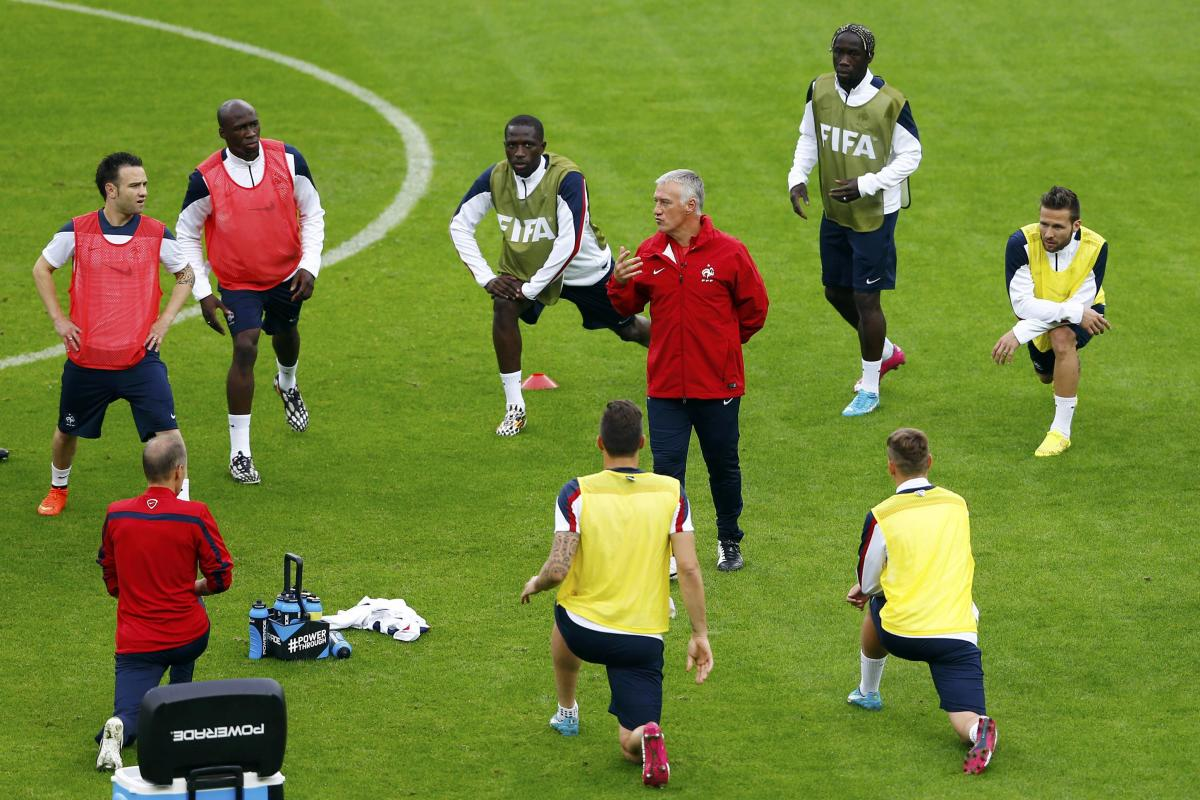 France's national soccer team coach Deschamps talks to players during a training session at the Beira-Rio stadium in Porto Alegre