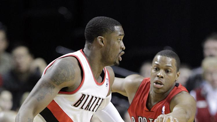 Portland Trail Blazers guard Wesley Matthews, left, drives on Toronto Raptors guard Kyle Lowry during the first half of an NBA basketball game in Portland, Ore., Saturday, Feb. 1, 2014